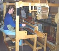 Kim weaving at one of her looms